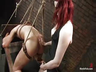 Furious red head dominatrix fucks her slave in BDSM