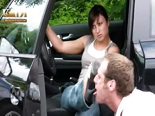 Foot slave cleaning her shoes before she enters her car